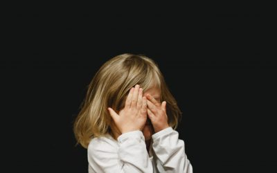 little girl hiding her face (shame)